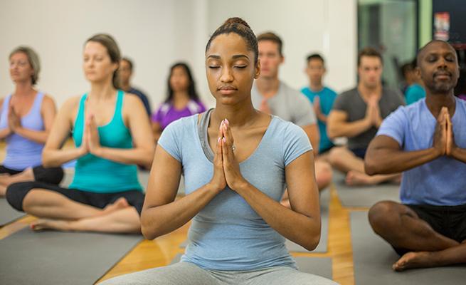 Yoga participants in meditation