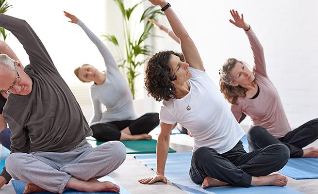 Participants doing yoga stretches